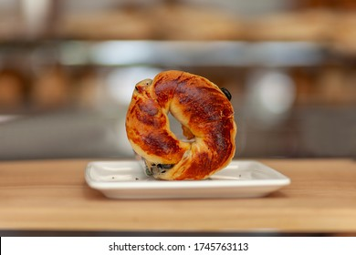 on the wooden table; bagel with olives in white plate / zeytinli acma