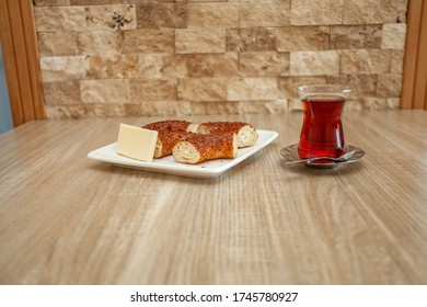 on the wooden table; turkish bagel, cheese and tea