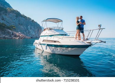 ?ouple on a Yacht. Luxury vacation on the Boat young man and woman. Sailing the Sea.