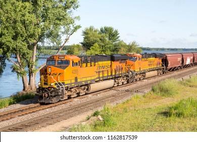 ONALASKA WISCONSIN USA. July 26 2018. A BNSF freight train running alongside the Mississippi Ruiver at Onalaska in Wisconsin, USA.