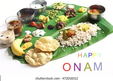 Onam feast on banana leaf isolated on white / Onam Feast with Happy Onam Text, selective focus