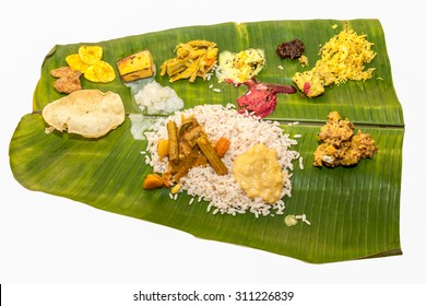 Onam Sadhya is Kerala vegetarian lunch served on a banana leaf on the occasion of festival Onam.Sambar,Rice,payasam,kichadi,pachadi,kalan,erishery,achaar