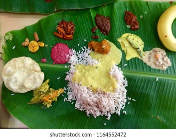 Onam sadhya served in banana leaf with lot of traditional dishes