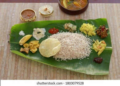 Onam sadhya served in banana leaf, south indian vegeterian meal arranged in traditional way,top view