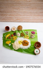 Onam sadhya served in banana leaf, south indian vegeterian meal arranged in traditional way