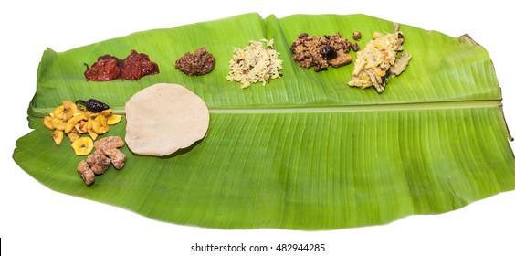 Onam Sadya. Traditional kerala Onam Sadhya with vegetable curries in banana leaf.