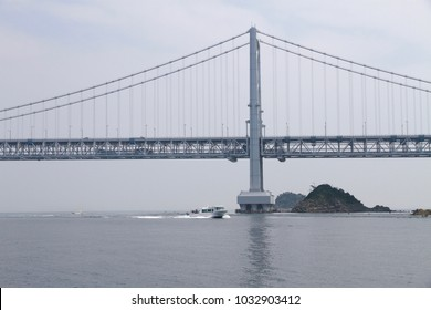 The Onaruto bridge and an excursion boat sails across the Naruto Strait.