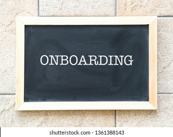 Onboarding, words printed on blackboard, a business or human resources cum training concept