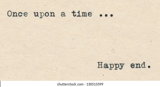 Once upon a time and Happy end written with a typewriter on an aged paper.
