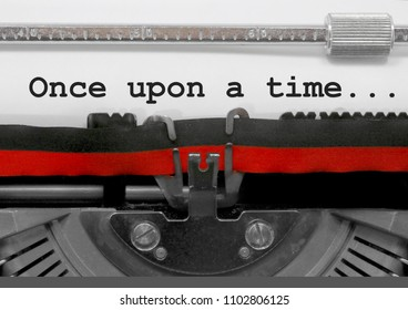 Once upon a time ... phrase written by an old typewriter on white sheet