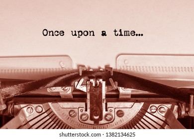 once upon a time... printed on paper on a vintage typewriter. writer, journalist.