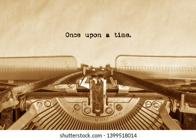 once upon a time printed on a sheet of paper on a vintage typewriter. literature, writer