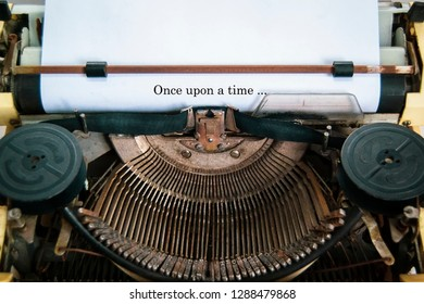 Once upon a time ...  The text is typed on paper with an old typewriter.