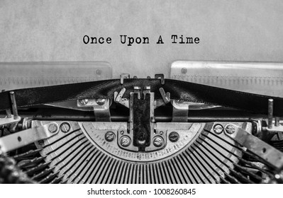 once upon a time, the text is written with old typewriter, close-up. Vintage, antiques