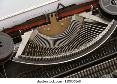 A once upon a time typed words on paper by a manual typewriter with mechanical components
