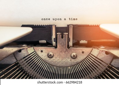 Once upon a time typed words on a vintage typewriter.  Selective focus and vintage tone color