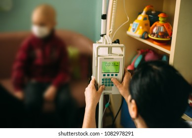 oncological child is sitting in hospital chemotherapy