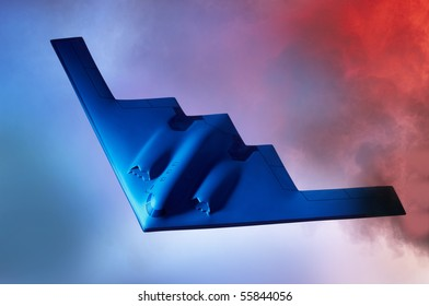 Oncoming Stealth B-2 Bomber shot against a blue orange sky with room for copy