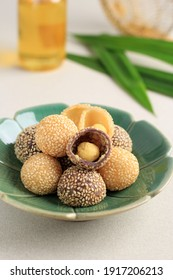Onde-onde or Glutinous Rice Sesame Seed Ball, Served on Indonesian Traditional Style Bali Plate. Close Up. Popular Indonesian Snack with Chinese Influence