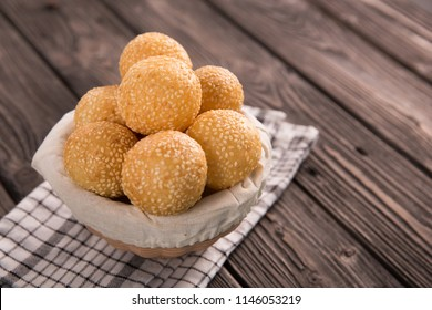 onde-onde. indonesian traditional street food. glutinous rice flour and stuffed inside a green bean paste with sesame seeds