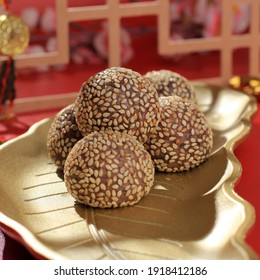 Onde-onde Ketan Hitam or Black Glutinous Rice Sesame Seed Ball, Served on Indonesian Traditional Style Bali Plate. Close Up. Popular Indonesian Snack with Chinese Influence
