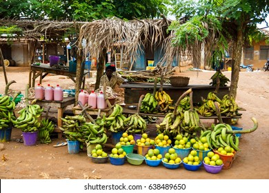 ONDO, NIGERIA - SEPTEMBER 30, 2012: Local fruit market in the street, where people sell local fresh fruit in a village at Ondo state in Nigeria, on September 30, 2012