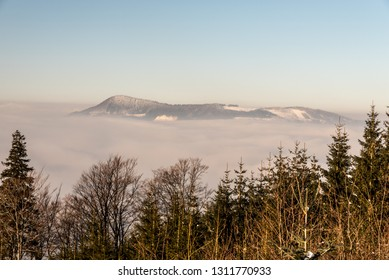 Ondrejnik mountain ridge with highest Skalka hill in Podbeskydska vrchovina mountains from hiking trail to Lysa hora hill in Moravskoslezske Beskydy mountains in Czech republic during winter