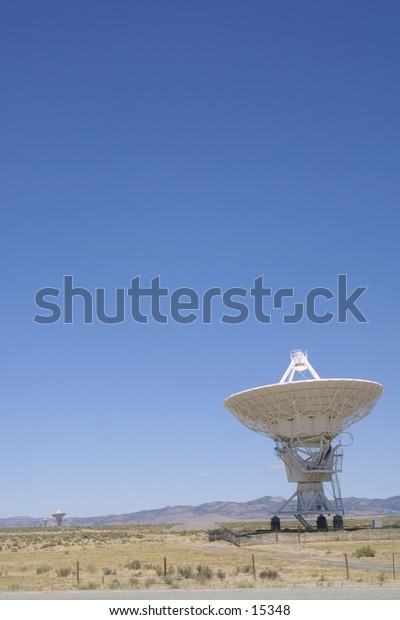 One of the 27 radio antenna at the Very Large Array telescope in new mexico.