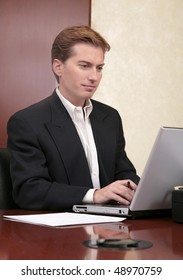 one adult male businessman working on a laptop computer in the office