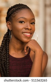 One African American girl poses for her senior portraits. Teen fashion. Teenage model.