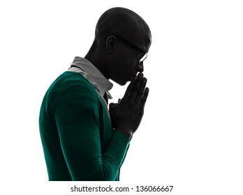 one african  black man  thinking pensive praying silhouette  in silhouette studio on white background