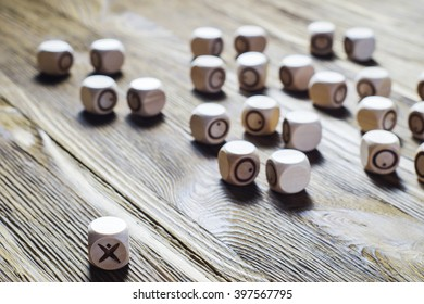 One against all, concept photo. Concept of business success. Uniqueness, independent, dissent, think differently. Wooden tic tac toe. XO.