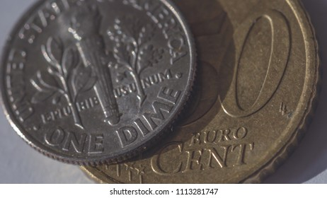 One American Dime on top of 50 Euro Cent B, shallow depth of field macro photography