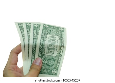 One American dollar banknote in hand isolated on white background, photo is out of focus.