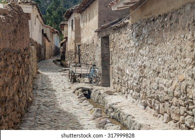One of ancient alleys of Ollantaytambo village, Sacred Valley of Incas, Peru