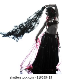 one arabic woman belly dancer dancing silhouette studio isolated on white background