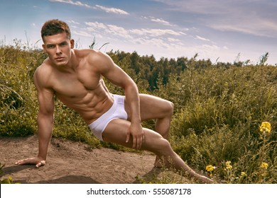 one athlete on the field in his underwear on a background of clouds and sun