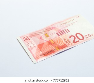 One banknote of a new type with a portrait of singer Rachel Bluwstein worth 20 Israeli shekels isolated on a white background