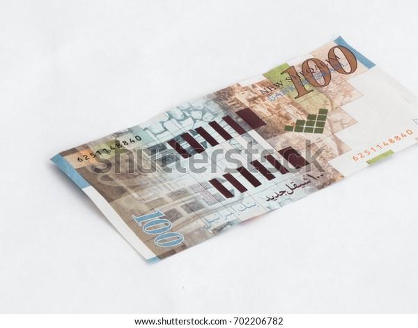 One banknote worth 100 Israeli shekels isolated on a white background