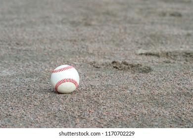 one baseball on infield of sport field