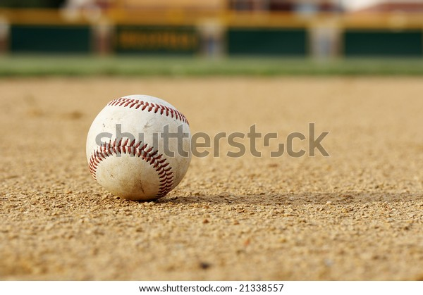 one baseball on infield of sport field