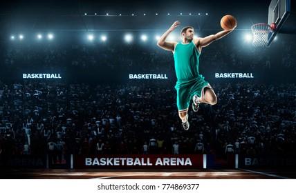 one basketball player jump in stadium panorama view