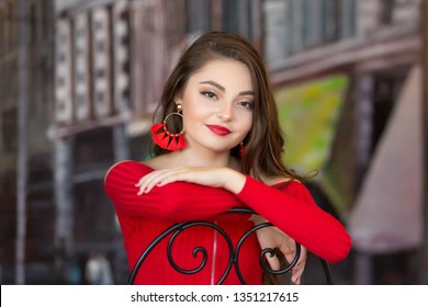 One beautiful female caucasain high school senior girl in red crop top sweater