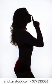 one beautiful woman in red underwear silhouette studio isolated on white background