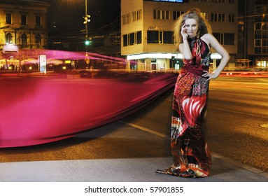one beautiful young elegant woman in fashion and urban style dress in  city on  street at night alone