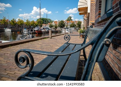 One of the best preserved historic cities of northern Netherlands with an inner harbor. View over canal with old sailing boats, pleasure yachts and historic buildings and old houses