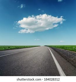one big cloud and asphalt road