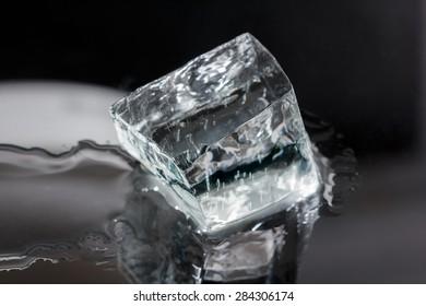 One big irregular shaped ice cube isolated on black