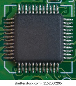 One big microscheme on motherboard with many legs. close-up view.