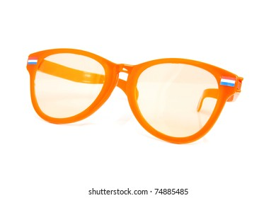 One big orange glasses with Dutch flags over white background